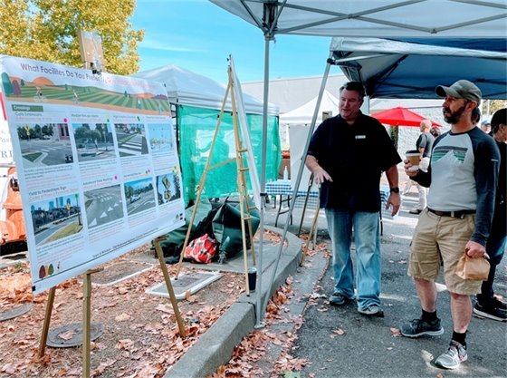Two men discussing update on Old Redwood Highway