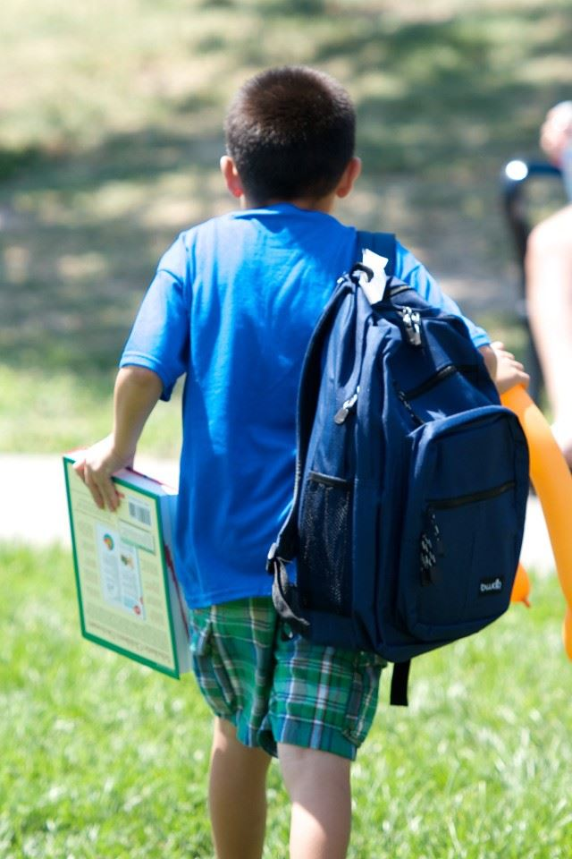 kid with backpack