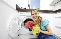 picture of woman and clothes washer